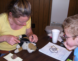 Cross 7 is full service.  Dr. Liz sews up a young client's 'stuffed' pet.